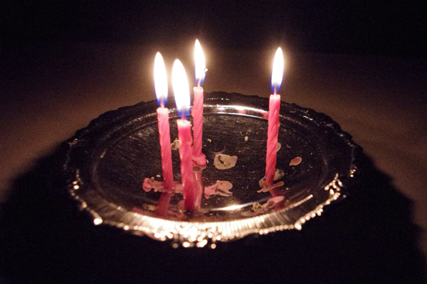Candles in an ash tray tray