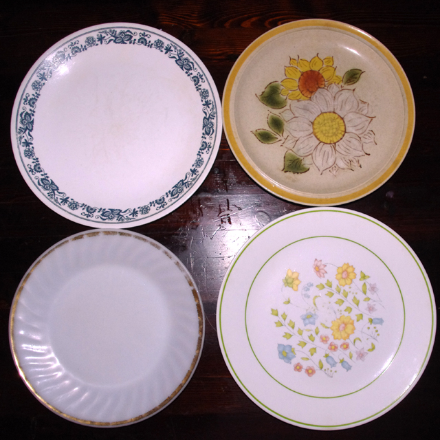 Four mismatched ugly dishes