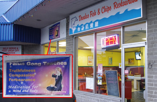 An advertisement for Falun Gong is prominently displayed next to the sign of of Dundas Fish & Chips