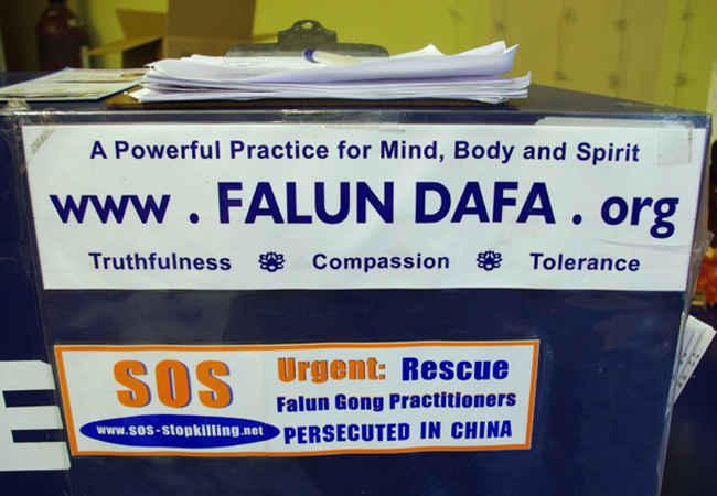 Falun Gong stickers and petition at the till