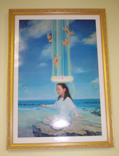 A large Falun Gong paintings in the restaurant.