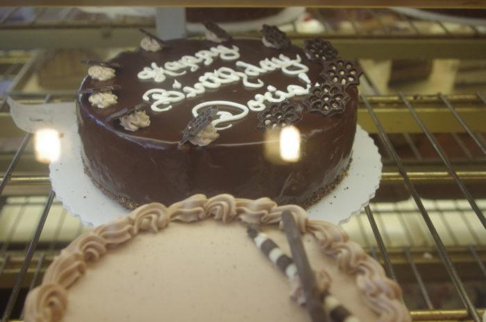 Doris' cake underneath the glass