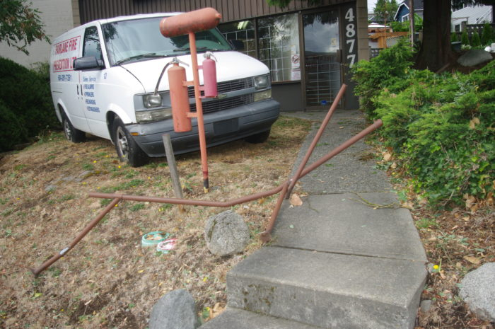 The metal railing at Fairlane Fire Prevention (4877 Hastings) was wiped out by the winds.