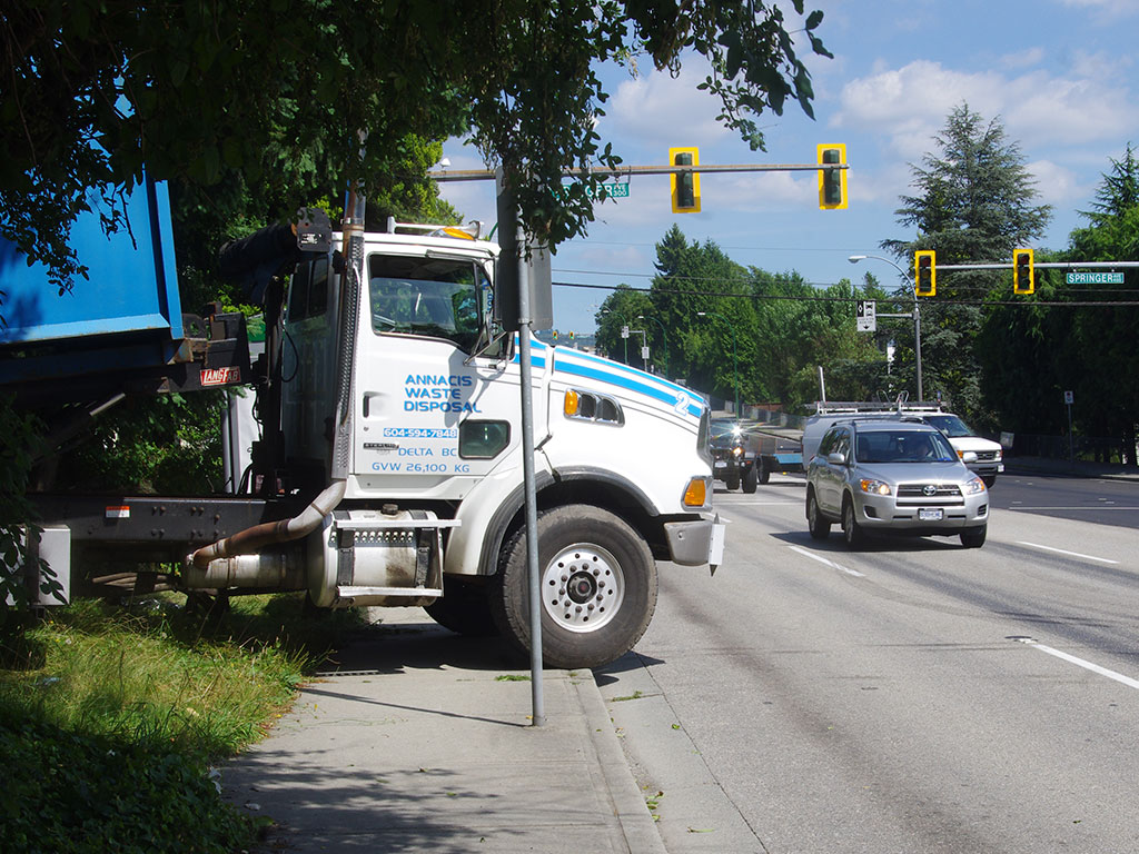 Dumptruck parked on the sidewalk near Hastings and Springer in Burnaby.